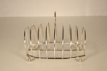 A George 111 sterling silver toast rack  SOLD