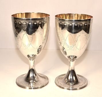 A pair of George 111 antique silver goblets