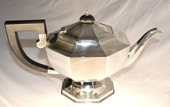 An art deco three piece silver tea set.