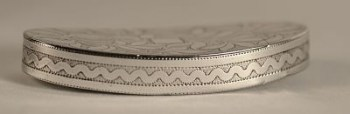A George 111 oval silver snuff box