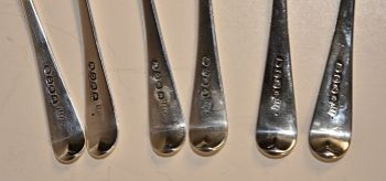 A set of six Old English pattern silver dessert spoons