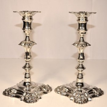 A pair of George 11 silver candlesticks