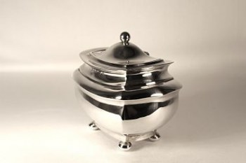 A silver art deco tea caddy