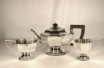 An art deco sterling silver tea set.